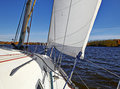 Yacht sailing on the lake in sunny autumn day Royalty Free Stock Photo