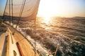 Yacht sailing during sunset Royalty Free Stock Photo