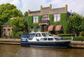 Yacht in scenic dutch town Stock Photo