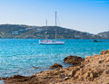Yacht in the sea around the island on a background of the sky Royalty Free Stock Photo