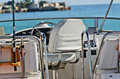 Yacht in the sea cabin boat with a leather chair and fishing rod Royalty Free Stock Photos
