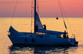 Yacht on sea sunset sailing against holiday lifestyle landscape with skyline sailboat yachting tourism maritime evening walk Royalty Free Stock Photos