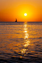 Yacht single in the sea at sunset Royalty Free Stock Photo