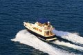 Yacht speeding up aerial view of a with splash and wake Royalty Free Stock Images