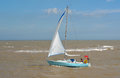 Yacht under sail at the estuary of the river Deben at Felixstowe Ferry. Royalty Free Stock Photo