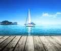 Yacht and wooden platform sky blue Stock Image