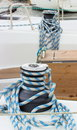 Yachting coiled rope on sailboat details of yacht and bollard and part Royalty Free Stock Photography