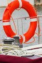 Yachting colorful rope with orange lifebuoy on sailboat coiled deck of part of yacht safety travel Stock Photography