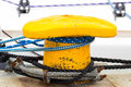 Yachting, colorful rope and yellow mooring bollard Royalty Free Stock Photo