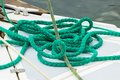 Yachting green rope on deck of sailboat details of yacht lying and part Stock Photos