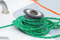 Yachting green rope on sailboat details of yacht coiled and bollard and part Royalty Free Stock Images