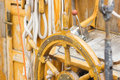Yachting helm of old wooden sailboat in port of sailing rope steering wheel details yacht Royalty Free Stock Photos