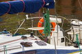 Yachting parts of sailboat in port of sailing coiled rope sail and orange lifebuoy details yacht Royalty Free Stock Image