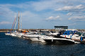 Yachts and boat boats anchored in sea port Stock Image