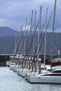 Yachts at dusk all lined up and docked the marina just on Royalty Free Stock Image