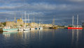 Yachts in harbor of Saint Malo, France, old town under storm cou Royalty Free Stock Photo