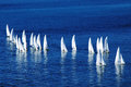 Yachts on the high seas several sailing across calm blue sea Royalty Free Stock Photos