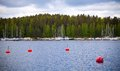 Yachts moorings buoys in small European marina Stock Images
