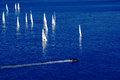 Yachts in the sea sailing on and boat floats intercept they Royalty Free Stock Photography