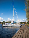 Yachts stand at the pier on background of sky Royalty Free Stock Image