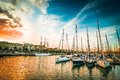 Yachts at sunset sea bay with Royalty Free Stock Photo