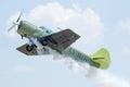 Yak aerobatics airplane in evolution at airshow Stock Photography