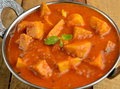 Yam curry indian dish made up of and tomatoes Stock Images