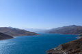Yamdrok lake the mountain and sky tibet winter Royalty Free Stock Photos