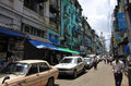 Yangon downtown street with old houses and cars Royalty Free Stock Image