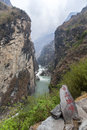 Yangtze river canyon a major tributary of the running through the narrow canyons of tiger leaping gorge with a sign painted in Stock Photos
