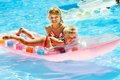 Yappy children swimming inflatable beach mattress Royalty Free Stock Photography