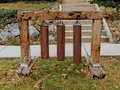 Yard Decoration of three rusted iron tube bells hanging by chains from railroad ties in Salt Lake City Utah along the Wasatch Fron Royalty Free Stock Photo