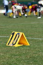 Yard line of a football field with blurred players in the background Royalty Free Stock Image