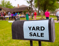 Yard sale in an american weekend on the lawn green Stock Photos