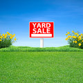 Yard sale sign green grass Stock Images