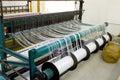 Yarn bobbins on loom framework Stock Photo