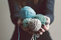 Yarn hands holding colorful balls of Stock Photography