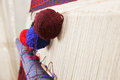 Yarn hanging on loom closeup photo Royalty Free Stock Photo