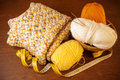 Yarn with knitting needles knitted thing and measuring tape skeins of on wooden background Stock Images