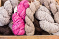 Yarn skeins in a wooden box Royalty Free Stock Photo