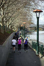 Yarra river melbourne victoria australia people jogging along the at southbank in Stock Image