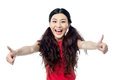 Yeah i am super excited girl showing double thumbs up Royalty Free Stock Photos