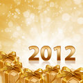 Year 2012 gold sparkling background and gift Royalty Free Stock Photography