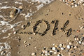 The year is ending now written in beach sand Royalty Free Stock Photos