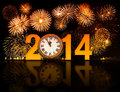 Year with fireworks and clock minutes before midnight displaying Royalty Free Stock Photo
