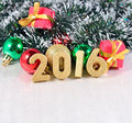 Year golden figures and christmas decorations on the background of Stock Photography