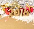 Year golden figures and christmas decorations on the background of Royalty Free Stock Photo