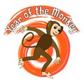 Year of the monkey. Monkey figurine on a fiery grunge background. Chinese horoscope symbol.