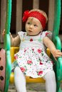Year old adorable little child girl sitting on a swing at summer almaty kazakhstan Royalty Free Stock Images