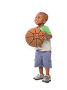 2 year old baby boy standing holding a basket ball Royalty Free Stock Photo